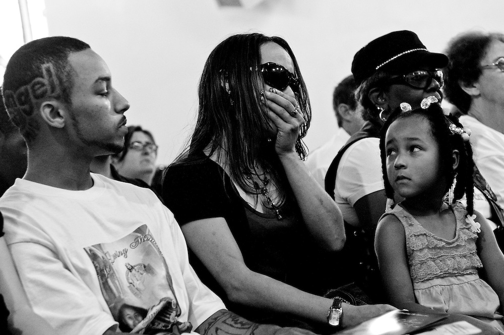 Mourners attend the funeral of 33 year-old Bernice King and her daughter Angel, 14, at the Pilgrim Baptist Church in Gary, Indiana. King was overcome by smoke and perished while trying to save her daughter when her home was set ablaze after an argument over an Xbox and a trade for marijuana. The suspected teen arsonist was shot 9 times the following morning and is now in custody facing murder and arson charges. (© William B. Plowman/Redux)