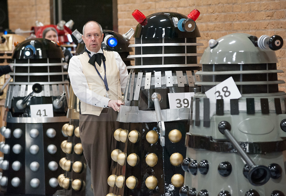 """© Licensed to London News Pictures. 10/03/2019; Chippenham, Wiltshire, UK. Dalek/Doctor Who themed charity event with an attempt on the Guinness World Record for the Largest Gathering of Daleks (currently set at 95 in 2008). The event narrowly missed out on the world record with 87 Daleks in total with 73 of those at full size. """"The Gathering"""" was held at The Olympiad Leisure Centre, a Dalek/Doctor Who themed charity event, with all profits in aid of Great Ormond Street Children's Hospital Charity and Julia's House Children's Hospice. There were various Who-related celebrity guests, talks, Q&As, cosplay competitions, and workshops. Photo credit: Simon Chapman/LNP"""