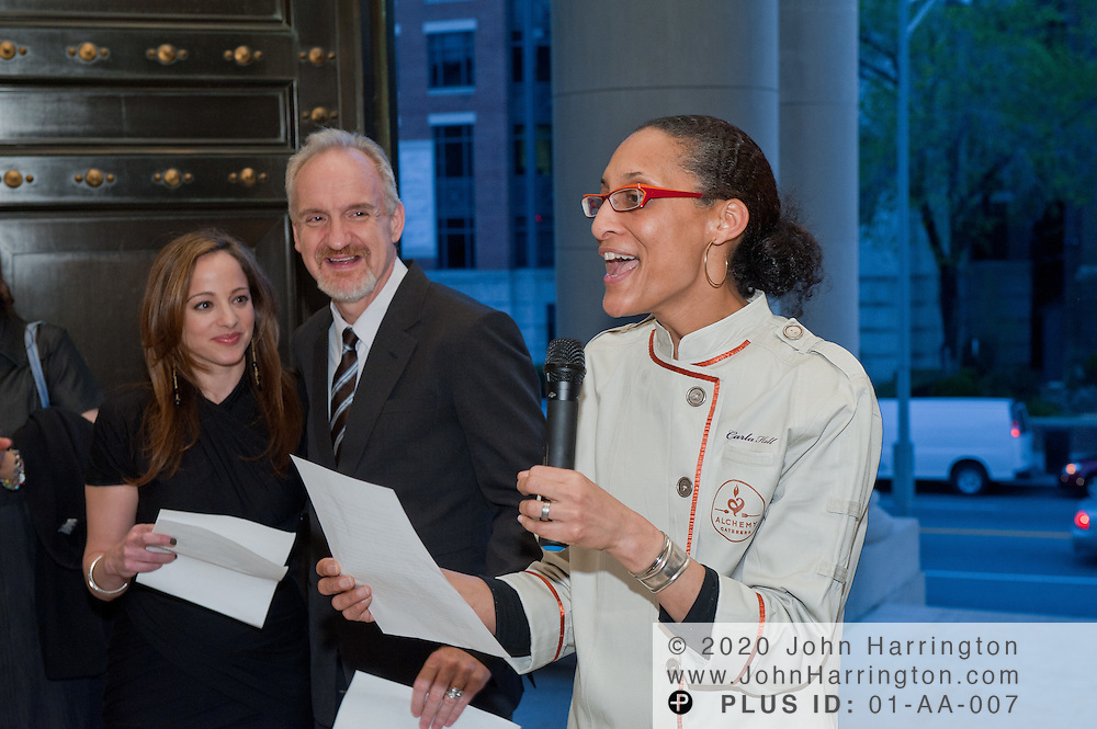 Chef Carla Hall of Alchemy and Bravo's Top Chef All Stars addresses the crowd while Common Threads Founder Chef Art Smith (Art and Soul), Linda Novick O'Keefe.Executive Director of Common Threads and Chef Kevin Sbraga (Bravo's Top Chef DC Winner) look on at the Carnegie Institution in Washington, DC on April 6th, 2011, brought together influential area chefs, politicians, and food enthusiasts for a fundraiser for after-school programs in Washington.