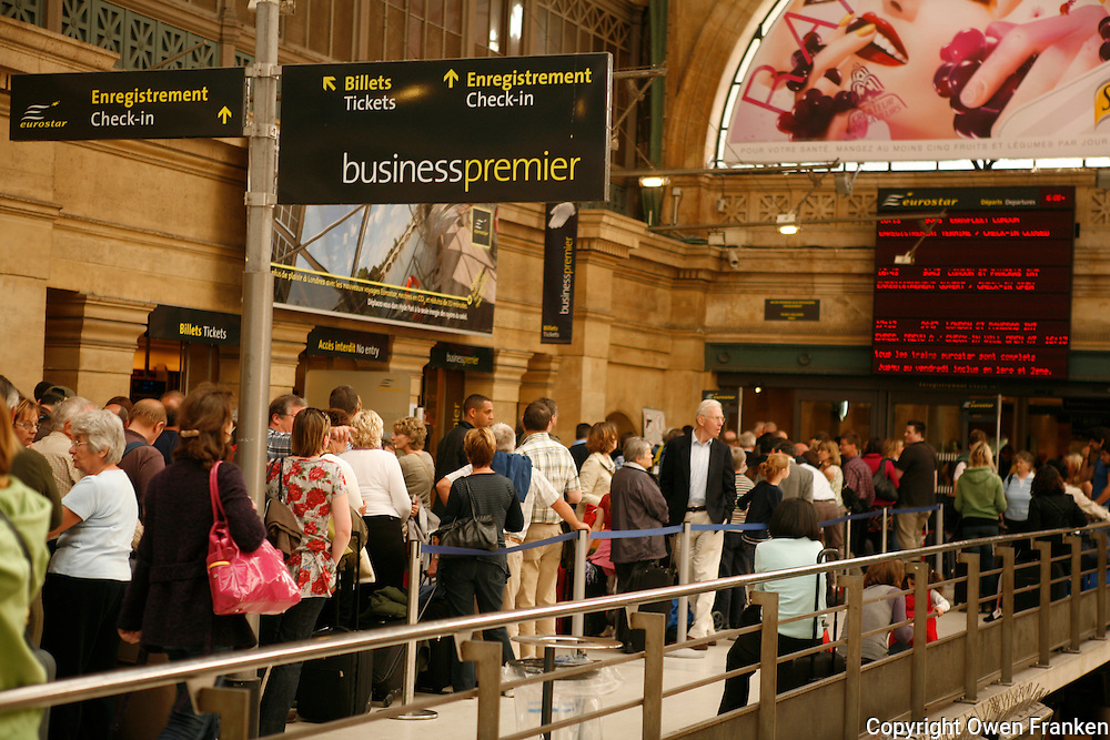 Pare Gare du Nord, Eurostar line Monday afternoon, the fourth day of the air stoppage due to the Icelandic Volcano..It was announced that all tickets have been bought for trains though midday Satrday, April 24..The line was fifty yards long..Monday April 19, 2010..Photograph by Owen Franken (on spec).