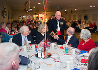 Retired Col. Norm Noel greets guests gathered at Pheasant Ridge Country Club for the 241st birthday celebration of the United States Marine Corps on Saturday evening.  (Karen Bobotas/for the Laconia Daily Sun)