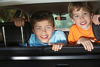 Portrait of boys (6-11) in car interior smiling