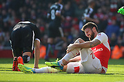 Arsenal striker, Oliver Giroud (12) taking a knock before being subbed during the The FA Cup Quarter Final match between Arsenal and Watford at the Emirates Stadium, London, England on 13 March 2016. Photo by Matthew Redman.