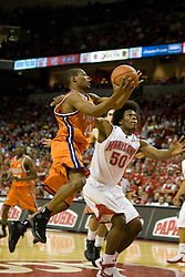 Virginia guard Sean Singletary (44) shoots over Maryland forward Bambale Osby (50).  The Maryland Terrapins defeated the Virginia Cavaliers men's basketball team 85-75 at the Comcast Arena in College Park, MD on January 30, 2008.