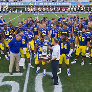 Delaware players receive The First State Cup from Delaware Gov. Jack Markell (Center) after defeating interstate State rival Delaware State University 42-21 Saturday. Sept Sept. 07, 2013 in Newark Delaware.