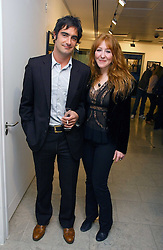VISCOUNT CASTLEREAGH and CHARLOTTE TILBURY at an exhibition of photographs entitled 'Protect The Human' by photographers Jake Gavin and Sean Gleason commissioned by Amnesty Internationlal and held at The Hospital, 24 Endell Street, London WC2 on 31st May 2006.<br />