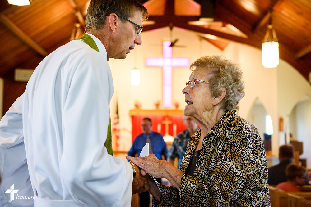 Margaret Stripling talks with the Rev. Steven Struecker, full-time farmer and pastor of Immanuel Lutheran Church, Livermore, Iowa, and Zion Evangelical Lutheran Church, Lu Verne, Iowa, following worship at the church in Livermore on Sunday, July 9, 2017. LCMS Communications/Erik M. Lunsford