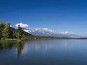 View across Lake Ianthe with the Wilberg Range of the Southern Alps in the background, West Coast, New Zealand.