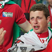 WELSH LEAK... A welsh fan in tears at the end of the game after his teams loss during the Wales V France Semi Final match at the IRB Rugby World Cup tournament, Eden Park, Auckland, New Zealand, 15th October 2011. Photo Tim Clayton...