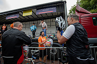 Kit bag handlers enjoy their work at the Queen Elizabeth Olympic Park. The Prudential RideLondon Sportives. Sunday 29th July 2018<br /> <br /> Photo: Andrew Baker for Prudential RideLondon<br /> <br /> Prudential RideLondon is the world's greatest festival of cycling, involving 100,000+ cyclists - from Olympic champions to a free family fun ride - riding in events over closed roads in London and Surrey over the weekend of 28th and 29th July 2018<br /> <br /> See www.PrudentialRideLondon.co.uk for more.<br /> <br /> For further information: media@londonmarathonevents.co.uk
