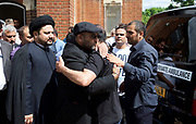 Ali Jafari's funeral prayers  <br /> Mr Ali Jafari, aged 82,  died following the fire at Grenfell Tower,<br /> 14th July 2017 <br /> <br /> Family being comforted outside the Hussaini Islamic Mission, Thornbury Road, Isleworth, <br /> <br /> <br /> Photograph by Elliott Franks <br /> Image licensed to Elliott Franks Photography Services