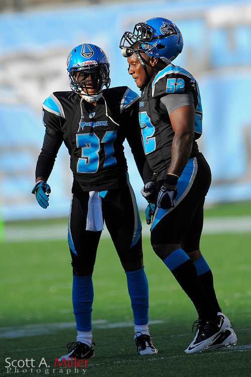 Sep 30, 2010; Orlando, FL, USA; Florida Tuskers defensive back David Irons (31) and linebacker Odell Thurman (52) prior to the Las Vegas Locomotives 20-17 win over the Tuskers at the Citrus Bowl. ..©2010 Scott A. Miller
