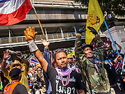 04 DECEMBER 2013 - BANGKOK, THAILAND:  Anti-government protestors in front of police headquarters in Bangkok. Several hundred anti-government protestors tried to occupy Royal Thai Police Headquarters on Rama I Road in central Bangkok Wednesday. The protest was one of the continuing protests against the government of Prime Minister Yingluck Shinawatra. Police commanders allowed protestors to tear down police barricades and ordered riot police to lay down their shields. Protestors then chanted anti-government slogans and called on police to turn against the government before forming a motorcade and leaving the area. Anti-government protests have gripped Bangkok for nearly a month and protestors vow to continue their actions. Protests Wednesday were much smaller and more peaceful than protests earlier in the week.     PHOTO BY JACK KURTZ