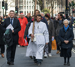 Westminster, London, March 25th 2016. Westminster's annual interdenominational Easter procession takes place with a procession from Methodist Central Hall to Westminster Cathedral and then on to Westminster Abbey, with the cross borne by people from The Passage, a homeless charity. PICTURED: The procession, led by a man from The Passage, a homeless charity heads towards Westminster Cathedral. <br /> ©Paul Davey<br /> FOR LICENCING CONTACT: Paul Davey +44 (0) 7966 016 296 paul@pauldaveycreative.co.uk