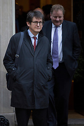 © licensed to London News Pictures. London, UK 04/12/2012. Alan Rusbridger, the editor of the Guardian leaving Downing Street as most editors of the national daily newspapers meeting the Prime Minister David Cameron to discuss ideas for a new system of press regulation. Photo credit: Tolga Akmen/LNP