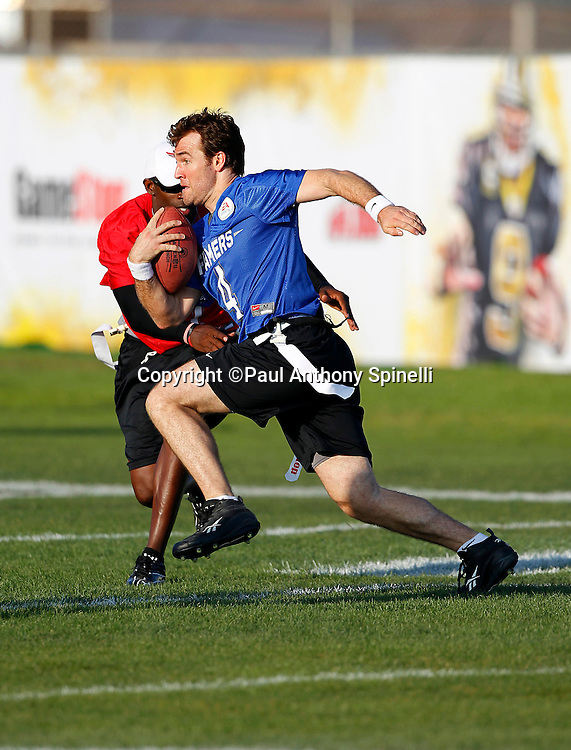 Actor James Van Der Beek (04) of the Famers team runs the ball as he plays flag football in the EA Sports Madden NFL 11 Launch celebrity and NFL player flag football game held at Malibu Bluffs State Park on July 22, 2010 in Malibu, California. (©Paul Anthony Spinelli)