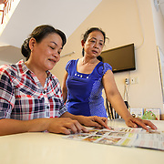 CAPTION: Healthcare practitioners Nguyen Thi Mai and Thuong Thi My Dung examine a leaflet which shows measures households can take to prevent dengue fever outbreaks. The leaflets, along with posters and other educational materials, are distributed in local communities to raise awareness of dengue fever prevention measures. LOCATION: Long Tuyen Health Centre, Can Tho, Vietnam. INDIVIDUAL(S) PHOTOGRAPHED: Nguyen Thi Mai, Thuong Thi My Dung.