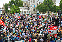 London, June 20th 2015. Thousands of people converge on the streets of London to join the People's Assembly Against Austerity's march from the Bank of England to Parliament Square. PICTURED: Part of the vast crowd packed in to Parliament Square for the post-march rally.