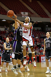 08 March 2008: Tiffany Hudson takes an underhanded lay up past a blocking Shannon Novosel. The University of Evansville Purple Aces and the Illinois State University Redbirds took the court looking for the MVC season title, but the Redbird win (87-72) split the title.  The game was played on Doug Collins Court in Redbird Arena in Normal Illinois.
