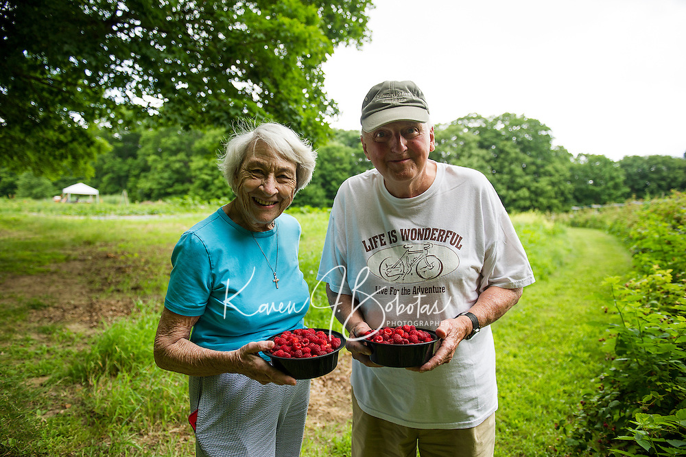 Anne Kynast visiting from Orlando, FL with Bill Bastraw of Laconia enjoy a morning of raspberry picking at Smith Farm Stand Thursday.  (Karen Bobotas/for the Laconia Daily Sun)