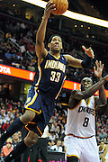 Feb. 2, 2011; Cleveland, OH, USA; Indiana Pacers small forward Danny Granger (33) shoots over Cleveland Cavaliers guard Christian Eyenga (8) during the third quarter at Quicken Loans Arena. The Pacers beat the Cavaliers 117-112. Mandatory Credit: Jason Miller-US PRESSWIRE