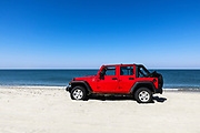 Parked SUV, Long Point Beach, Nantucket, Massachusets, USA.