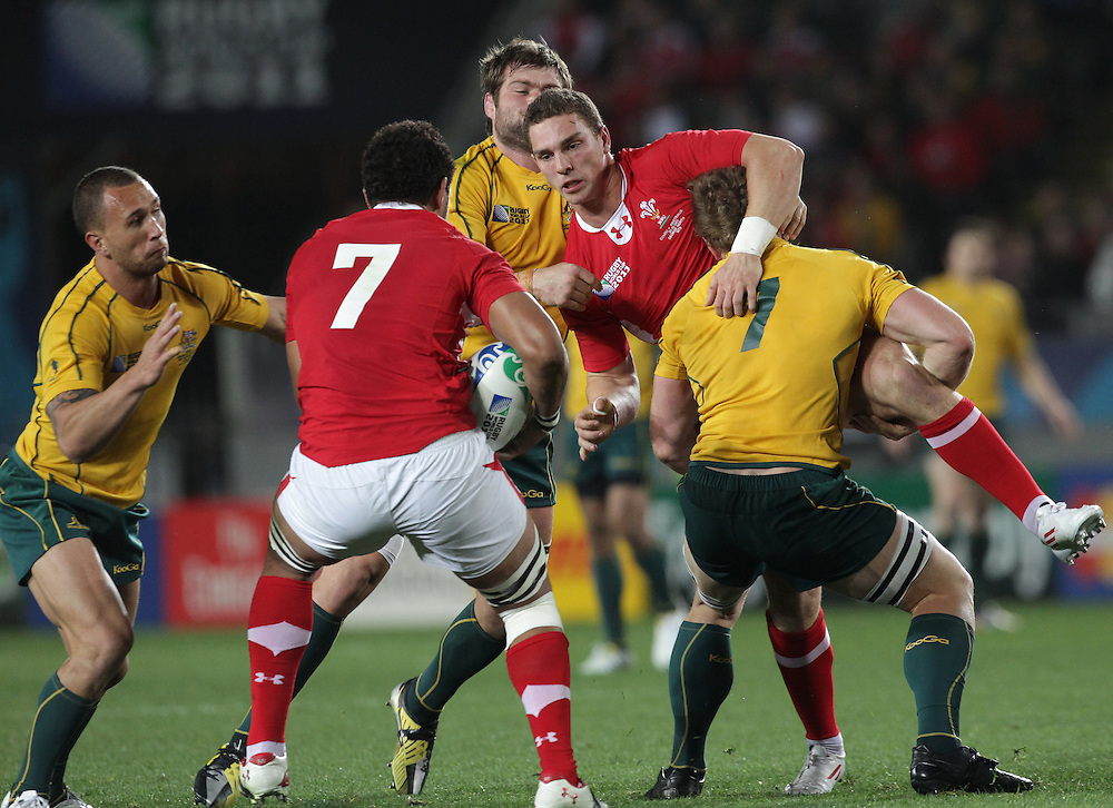 Wales George North is tackled by Australia's David Pocock as he passes the ball to Toby Faletau during the bronze final match of the Rugby World Cup 2011, Eden Park, Auckland, New Zealand, Friday, October 21, 2011.  Credit:SNPA / David Rowland