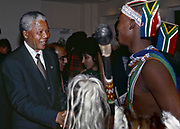 Nelson Mandela greets praise singer Zolani Mkiva during a function in Camps Bay, Cape Town 1995<br /> <br /> Photograph &copy; nic bothma