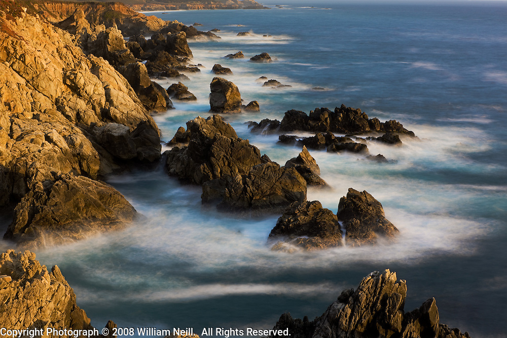 Coastal rock formations and surf at sunset, Garrapata Beach, Big Sur, California