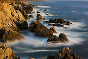 Coastal rock formations and surf at sunset, Garrapata Beach, Big Sur, California