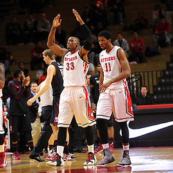 (L-R) Craig Brown #15, Wally Judge #33, Kadeem Jack #11 and D'Von Campbell #55 walk off the court after taking the lead in the second half of Rutgers men's basketball vs Temple Owls in American Athletic Conference play on Jan. 1, 2014 at Rutgers Louis Brown Athletic Center in Piscataway, New Jersey.