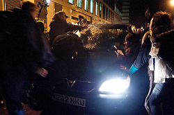 © licensed to London News Pictures. London, UK. 30/01/12. Bailiff drives vehicle at speed through group of protestors, he is now believed to have been arrested. Bailiffs & police move to evict the 'Bank of Ideas' squatted UBS property on sun street and adjacent squat on Earl Street, EC2 after UBS obtained a possession order for the property. Photo credit: Jules Mattsson/LNP