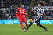 Liverpool midfielder Jordan Ibe puts the ball into the box  during the Barclays Premier League match between Newcastle United and Liverpool at St. James's Park, Newcastle, England on 6 December 2015. Photo by Simon Davies.