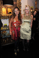 Left to right, JADE JAGGER and LADY KITTY SPENCER wearing Burberry at the opening of Jade Jagger's shop at 43 All Saints Road, London W11 on 25th November 2009.