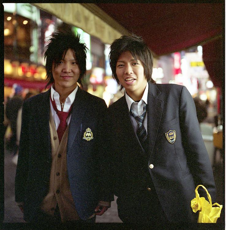 Two Gal-O boys still in school uniforms, Shibuya, Tokyo, Japan