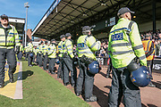 The police are out in force to stop any more pitch invasions and the two sets of fans coming together during the EFL Sky Bet League 1 match between Port Vale and Bolton Wanderers at Vale Park, Burslem, England on 22 April 2017. Photo by Mark P Doherty.