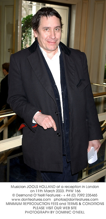 Musician JOOLS HOLLAND at a reception in London on 11th March 2003.	PHW 166
