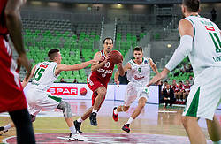 Yotam Halperin of Hapoel between Gregor Hrovat #15 of KK Union Olimpija and Blaz Mesicek #9 of KK Union Olimpija during basketball match between KK Union Olimpija Ljubljana (SLO) and Hapoel Jerusalem (ISR) in Round #4 of 7Days EuroCup 2016/17, on October 26, 2016 in Arena Stozice, Ljubljana, Slovenia. Photo by Vid Ponikvar / Sportida