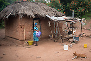 A mother returns to her home, carrying a powerless water filtration system provided by volunteers with Ghanaian Mothers Hope, near Akosombo, Ghana, Thursday, July 27, 2017. Ghanaian Mothers' Hope is a US based non-profit working to bring clean water, education, and healthcare to Ghanaian Villages in need.