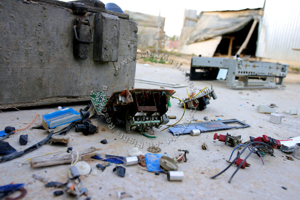 Electrical apparels are stripped and its usable parts recycled for other needs in unrecognised village of Wadi el Na'am, pop. 4000, close to Beer Sheva, the capital of the Negev, a large deserted area in the south of Israel. Wadi el Na'am is located near a large industrial site, Ramat Hovav, and has no infrastructure or electric energy. Water is provided only via storage tanks. It has no health services as the only clinic is deemed illegal and bound to be demolished, as the rest of the structures in the area. Numbering around 200.000 in Israel, the Bedouins constitute the native ethnic group of these areas, they farm, grow wheat, olives and live in complete self sufficiency. Many of them were in these lands long before the Israeli State was created and their traditional lifestyle is now threatened by subtle Governmental policies. The seven Bedouin towns already built are all between the 10 more impoverished towns in Israel. .