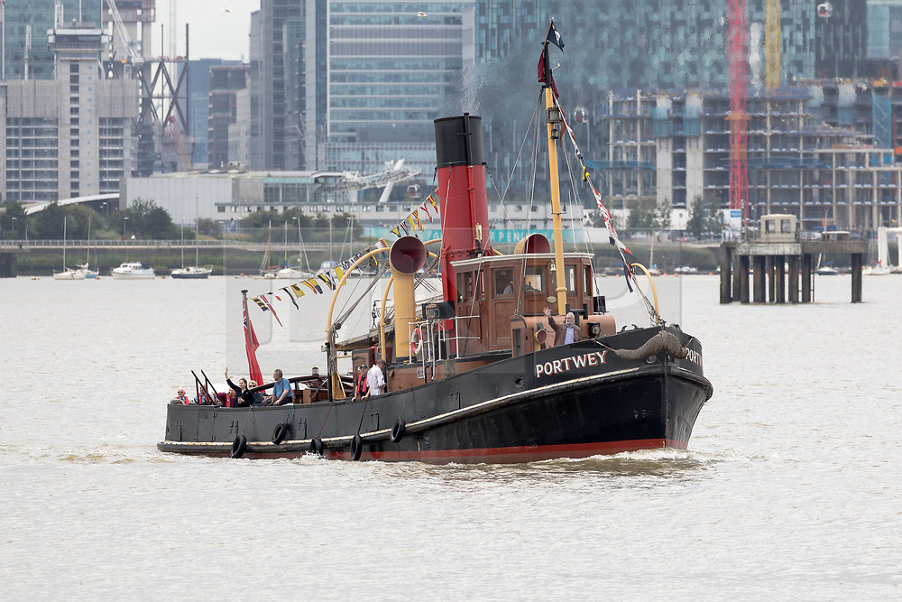 © Licensed to London News Pictures. 04/08/2017. LONDON, UK.  Steam Tug (ST) Portwey steams along the River Thames in London, travelling to Gravesend to take part in a series of events marking her 90th birthday, including a salute by Commander Richard Pethybridge at the Royal Navy's HMS President on the way. The ST Portwey was built on the Clyde in 1927, came under the command of the Royal Navy during the Second World War when she was based in Dartmouth and carried out rescues of vessels and crews sunk by enemy action in the Channel and is the only twin screw, coal fired steam tug still active in the whole of the United Kingdom.  Photo credit: Vickie Flores/LNP
