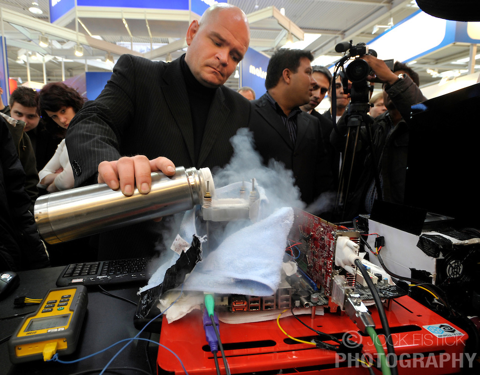 HANNOVER, GERMANY - MARCH-7-2008 - Foxconn, a manufacturer of PC motherboards, was demonstrating how keeping the processor cool improved performance by pouring liquid CO2 over an exposed processor and monitoring the results. . (Photo © Jock Fistick)