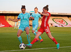 NEWPORT, WALES - Tuesday, June 12, 2018: Russia's captain Anna Kozhnikova (left) and Wales' Rachel Rowe during the FIFA Women's World Cup 2019 Qualifying Round Group 1 match between Wales and Russia at Newport Stadium. (Pic by David Rawcliffe/Propaganda)