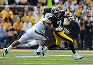 September 17, 2011: Iowa Hawkeyes wide receiver Marvin McNutt (7) is hit by Pittsburgh Panthers defensive back K'Waun Williams (2) during the first half of the game between the Iowa Hawkeyes and the Pittsburgh Panthers at Kinnick Stadium in Iowa City, Iowa on Saturday, September 17, 2011. Iowa defeated Pittsburgh 31-27.
