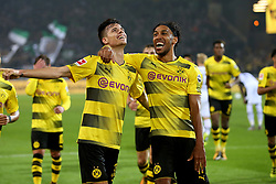DORTMUND, Sept. 24, 2017  Julian Weigl (L) of Borussia Dortmund celebrates with Pierre-Emerick Aubameyang after scoring during the Bundesliga match between Borussia Dortmund and Borussia Moenchengladbach at the Signal Iduna Park in Dortmund, Germany, on Sept. 23, 2017. Dortmund won the match by 6-1. (Credit Image: © Joachim Bywaletz/Xinhua via ZUMA Wire)