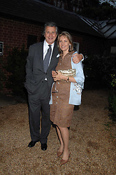 ARNAUD & CARLA BAMBERGER at the annual Cartier Chelsea Flower Show dinner held at the Chelsea Physic Garden, London on 21st May 2007.<br />