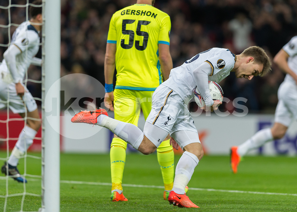 Christian Eriksen of Tottenham Hotspur celebrates scoring the opening goal during the UEFA Europa League  Round of 32 Game 2 match between Tottenham Hotspur and Gent at Wembley Stadium, London, England on 23 February 2017. Photo by Vince  Mignott.