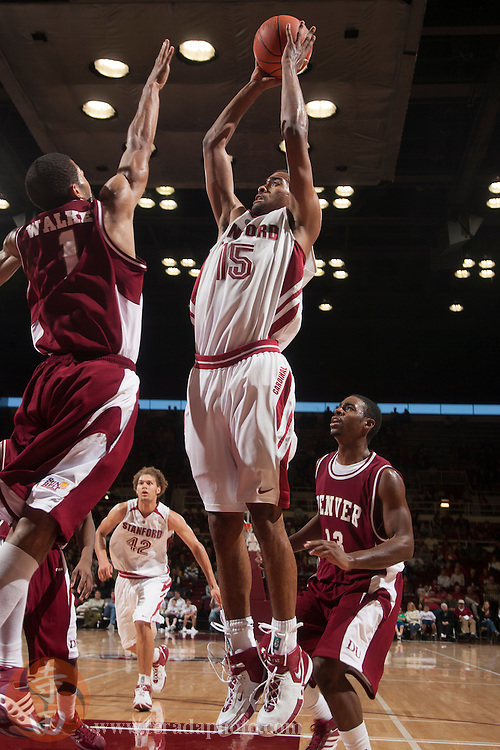 November 25, 2006; Stanford, CA, USA; Stanford Cardinal forward Lawrence Hill (15) shoots the basketball against Denver Pioneers guard DaShawn Walker (1) during the game at Maples Pavilion. The Cardinal defeated the Pioneers 82-39.