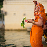 Women at Lal Ghat at sunset