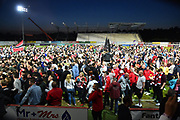 Exeter City fans invade the pitch to celebrate at full time the 3-1 win over Lincoln City which takes Exeter to Wembley for the League 2 play-off final during the EFL Sky Bet League 2 match between Exeter City and Lincoln City at St James' Park, Exeter, England on 17 May 2018. Picture by Graham Hunt.